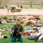 Chemical bombing of Halabja, 16 March 1988, during the Baathist Regime's Al-Anfal campaign against the Kurds (1986-1988), with photographer Ramazan Öztürk in the foreground.   Source: http://www.4law.co.il/sasad309.jpg